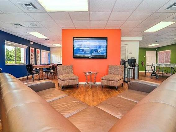 Relax on the spacious couch and watch TV in our common area.