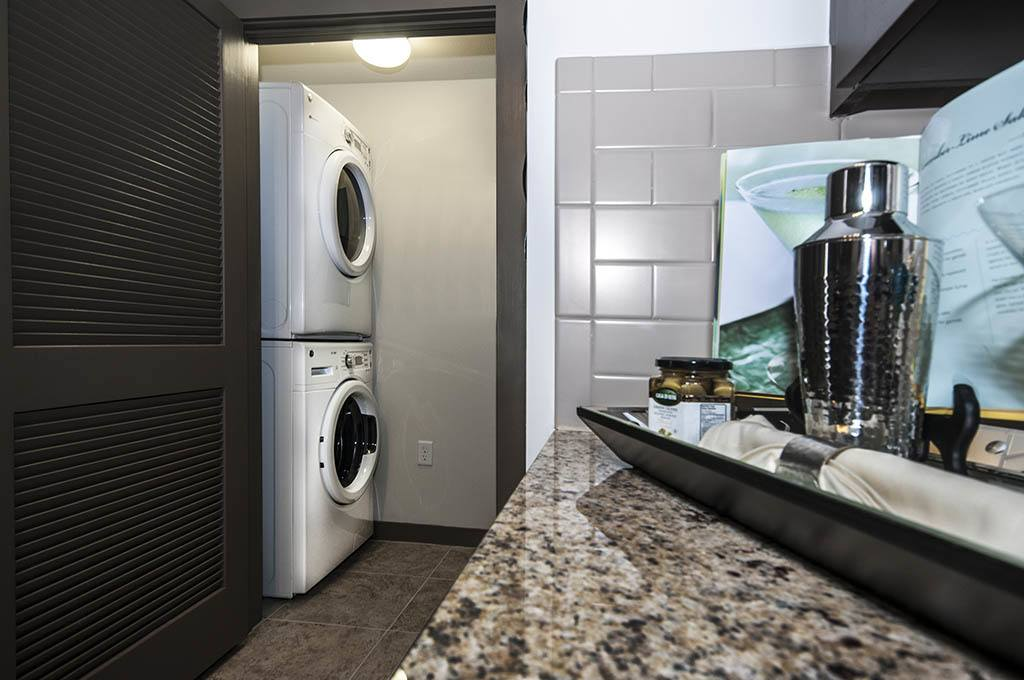 Laundry room inside apartment at Alta Congress