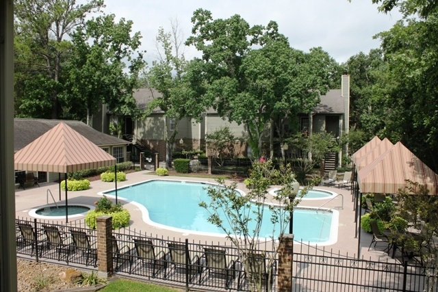 A view of the pool at Woodwind Village Apartments