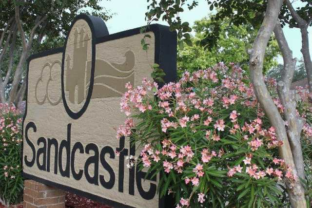 Sandcastle welcome sign at Sandcastle Apartments