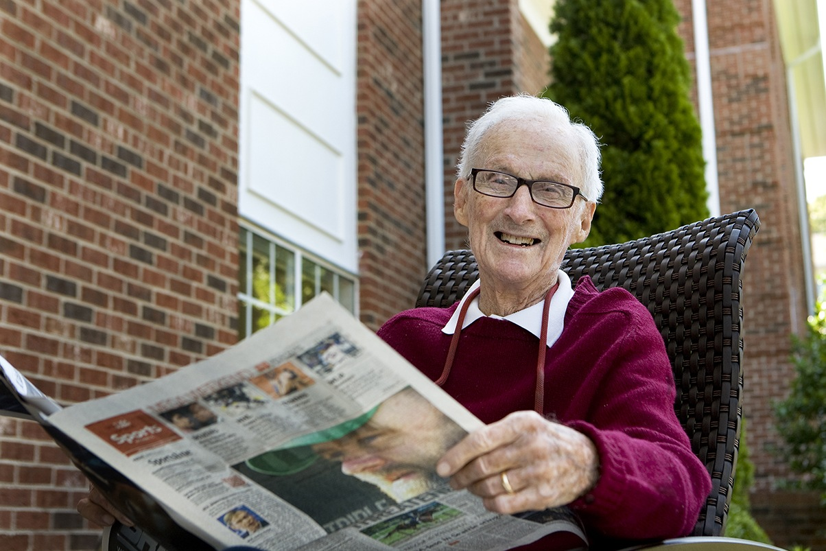 Read The Paper On A Patio At Senior Living In Greensboro North Carolina