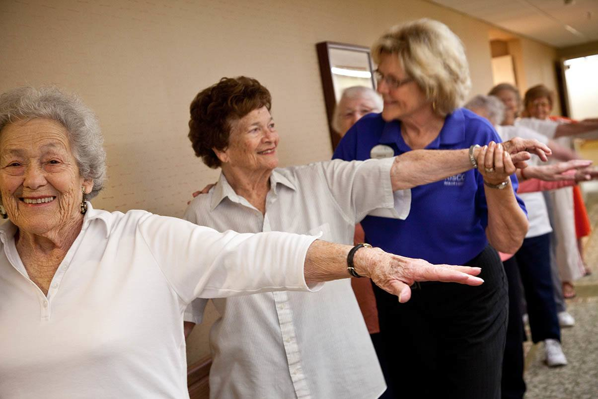 Happy senior women getting exercise at Cypress Court