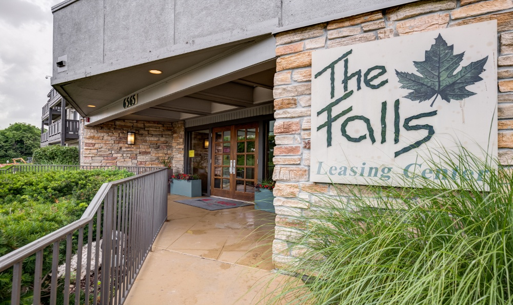 Entrance sign at The Falls apartments
