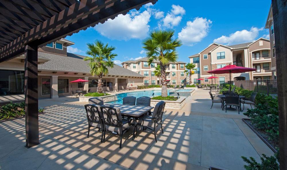 Pool and waterfalls at The Oaks at Northpointe apartments in Tomball, TX