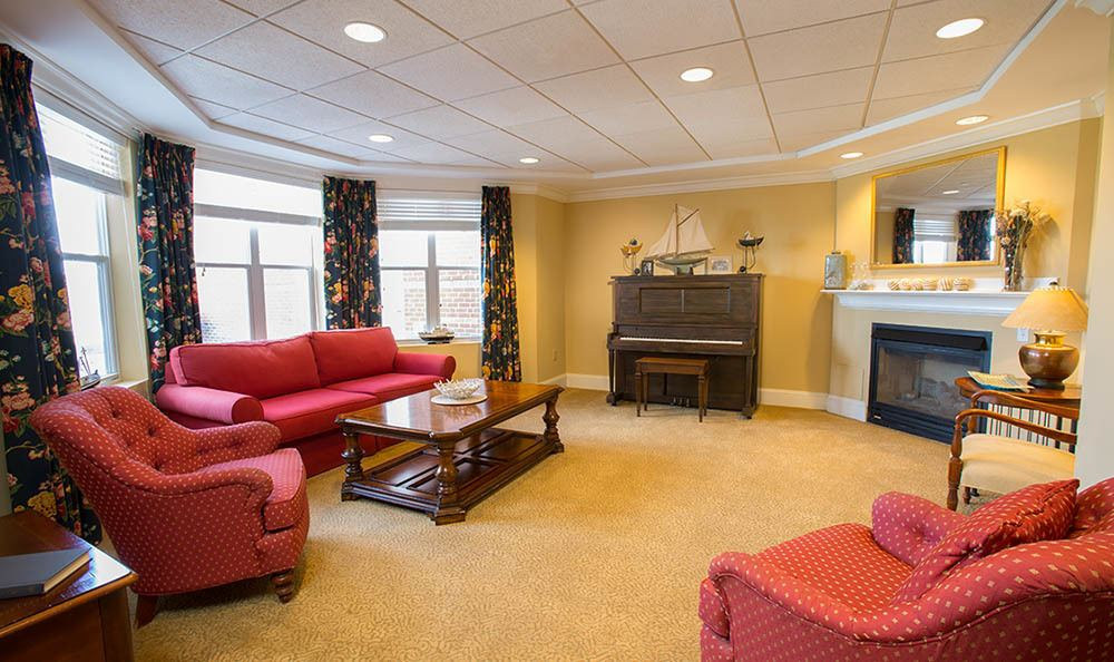 Piano and seating at senior living in Mystic