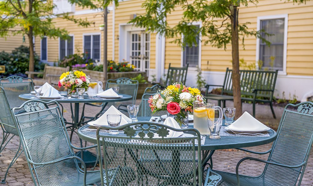 Enjoy dining outdoors in nice weather at Carriage Green at Milford