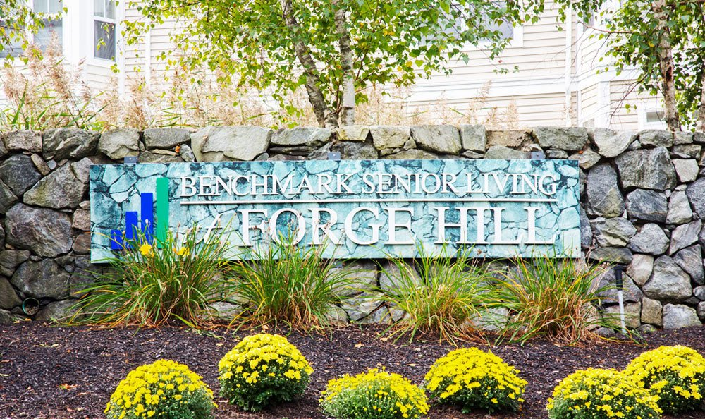 Sign to Entrance Senior Living at Forge Hill