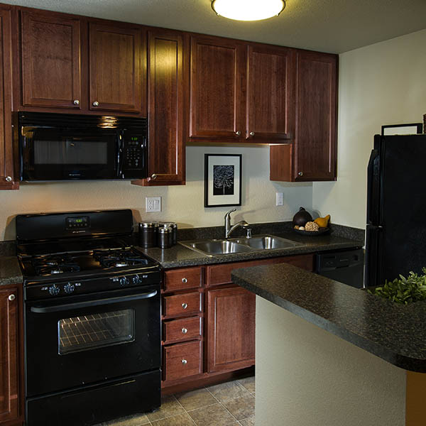 Kitchen With Granite Countertops at UCA Apartment Homes