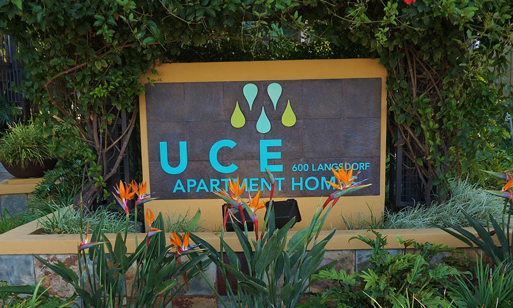 Signage at UCE Apartment Homes in Fullerton, CA