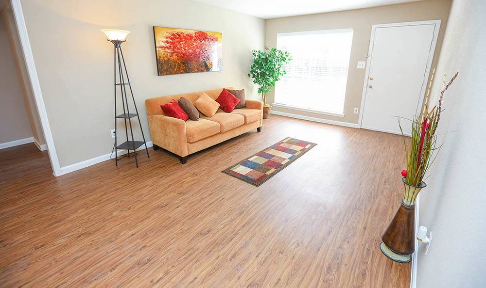 One Pine Apartments Living Room With Hardwood Floors