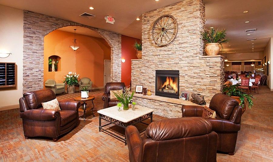 Rockllin senior living community has a cozy fireplace