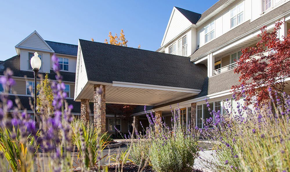 Clean exterior building at The Wellington senior living facility in Salt Lake City