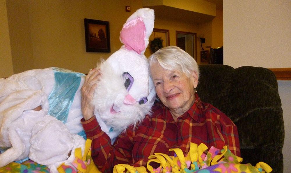 Resident with easter bunny at Loveland senior living community
