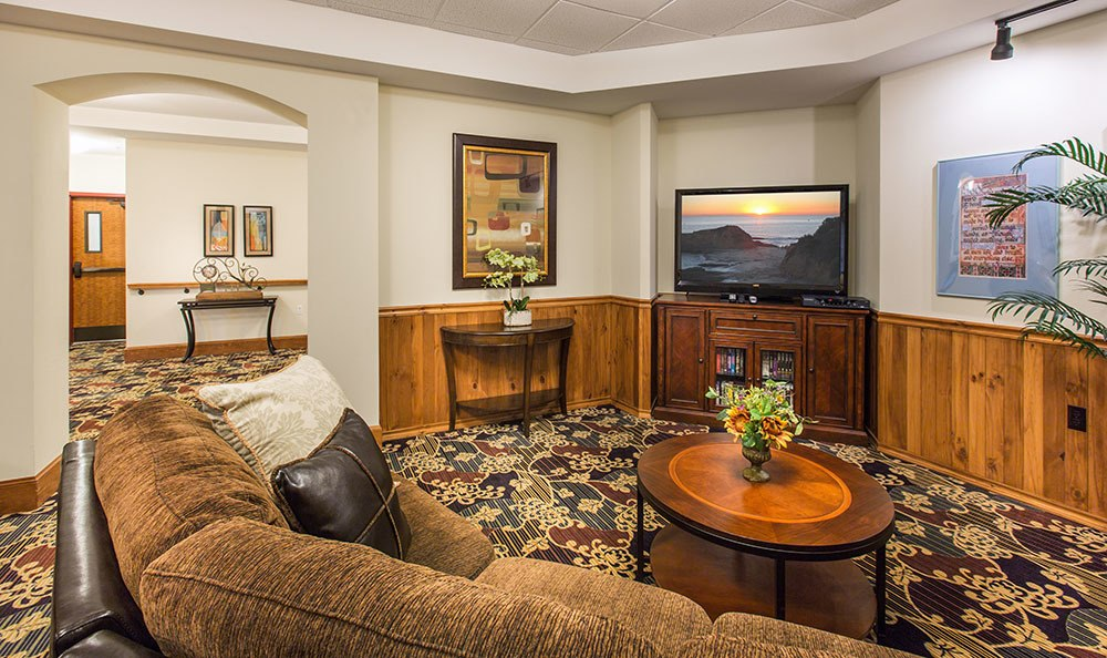 TV area with couches at the senior living community in Loveland