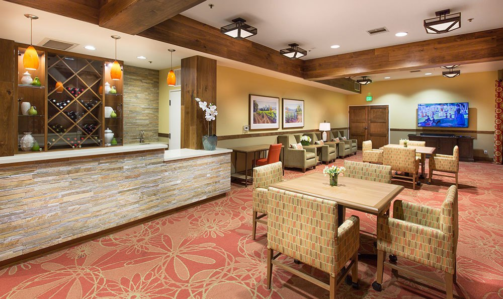 Beautiful bar and dining area at senior living community at Oakmont Gardens