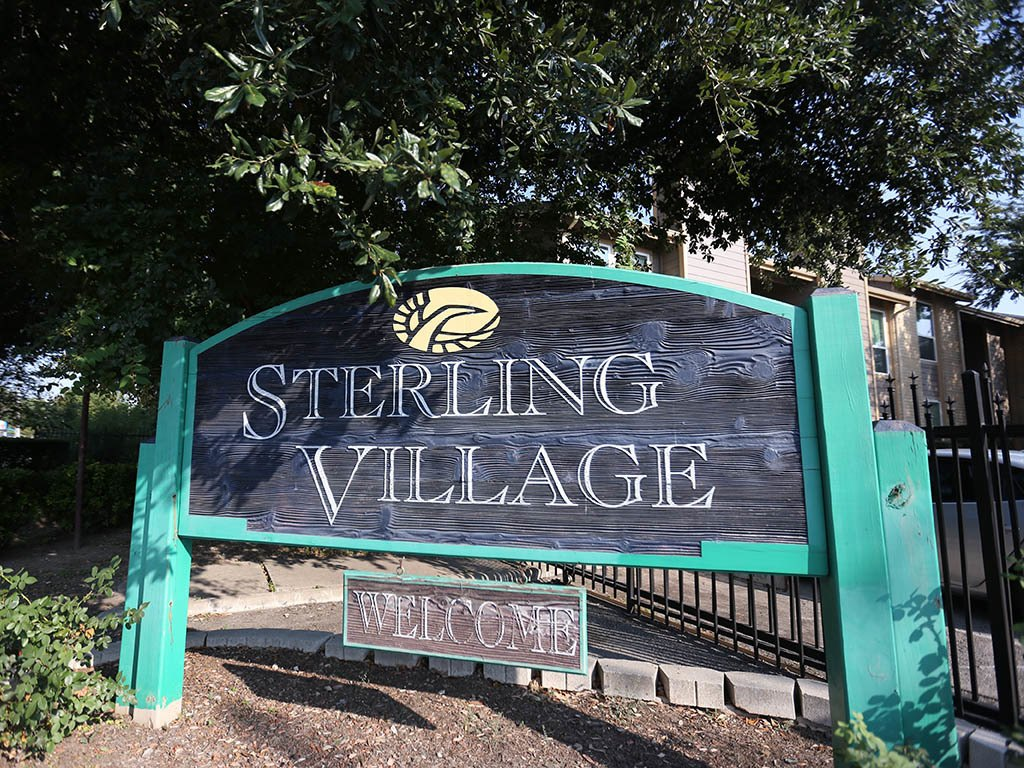 Sign outside of Sterling Village Apartments