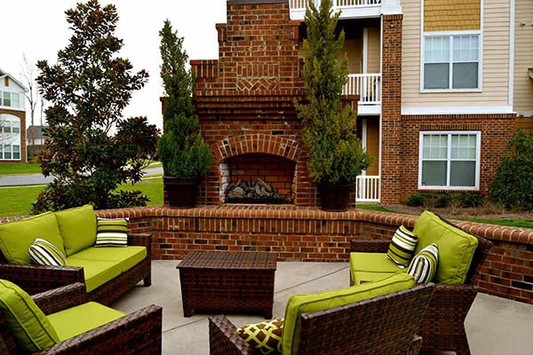 Relax at our outdoor fireplace and patio area at Preserve at Steele Creek