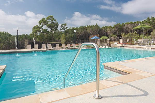 Resort Style Pool With Water Feature At Out Austin Apartments