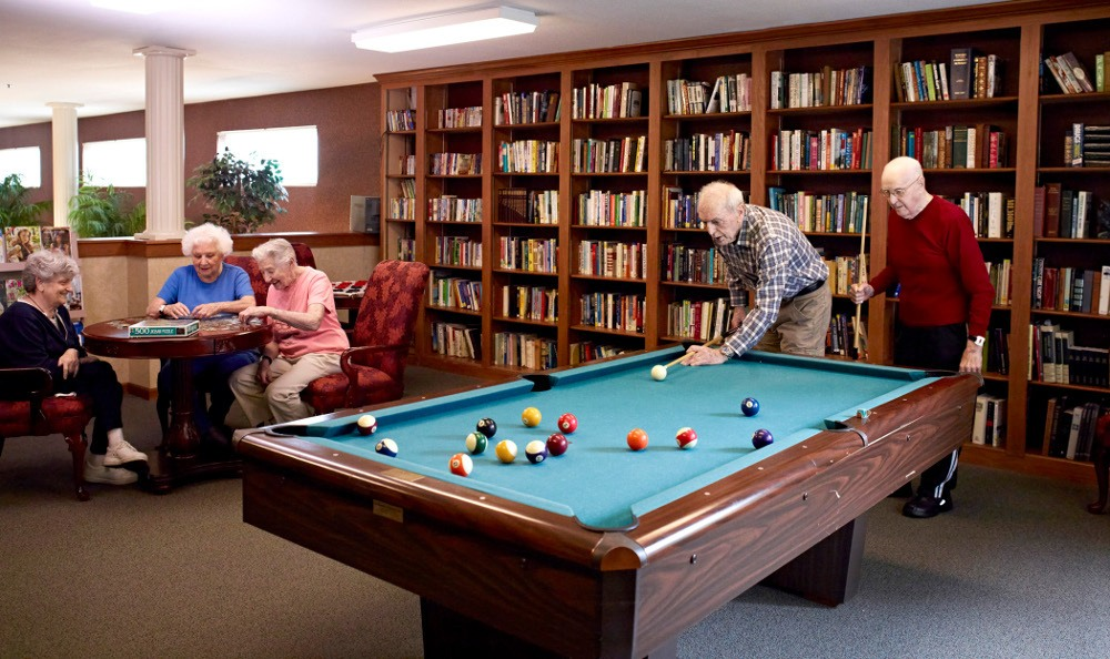 Friends Playing Pool At Senior Living In Taylor, MI
