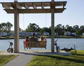 Family on a swing at Westlake RV Resort