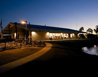 Night time view of the clubhouse for the RV resort in Houston