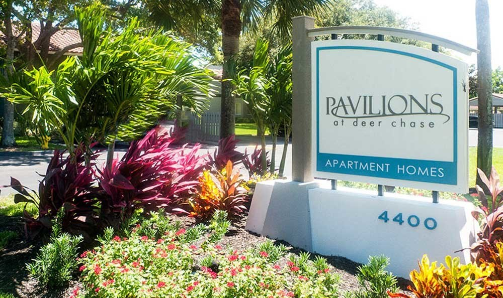 Apartment signage at Pavilions at Deer Chase in Deerfield Beach, FL