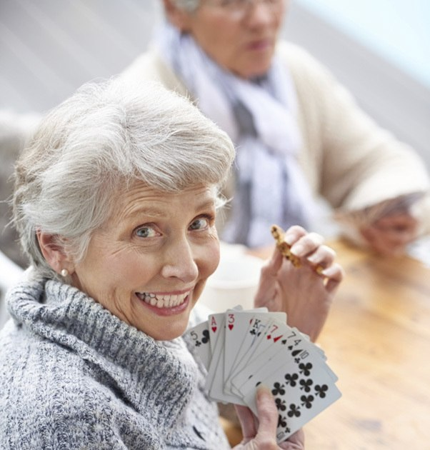 Seniors playing cards at Fox Hollow Independent and Assisted Living in Bend, OR
