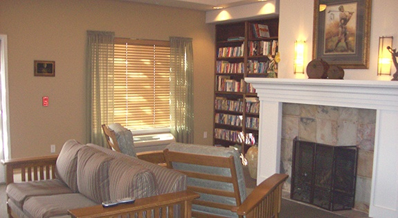 Sit around the fireplace in our lobby at Fox Hollow Independent and Assisted Living in Bend, OR