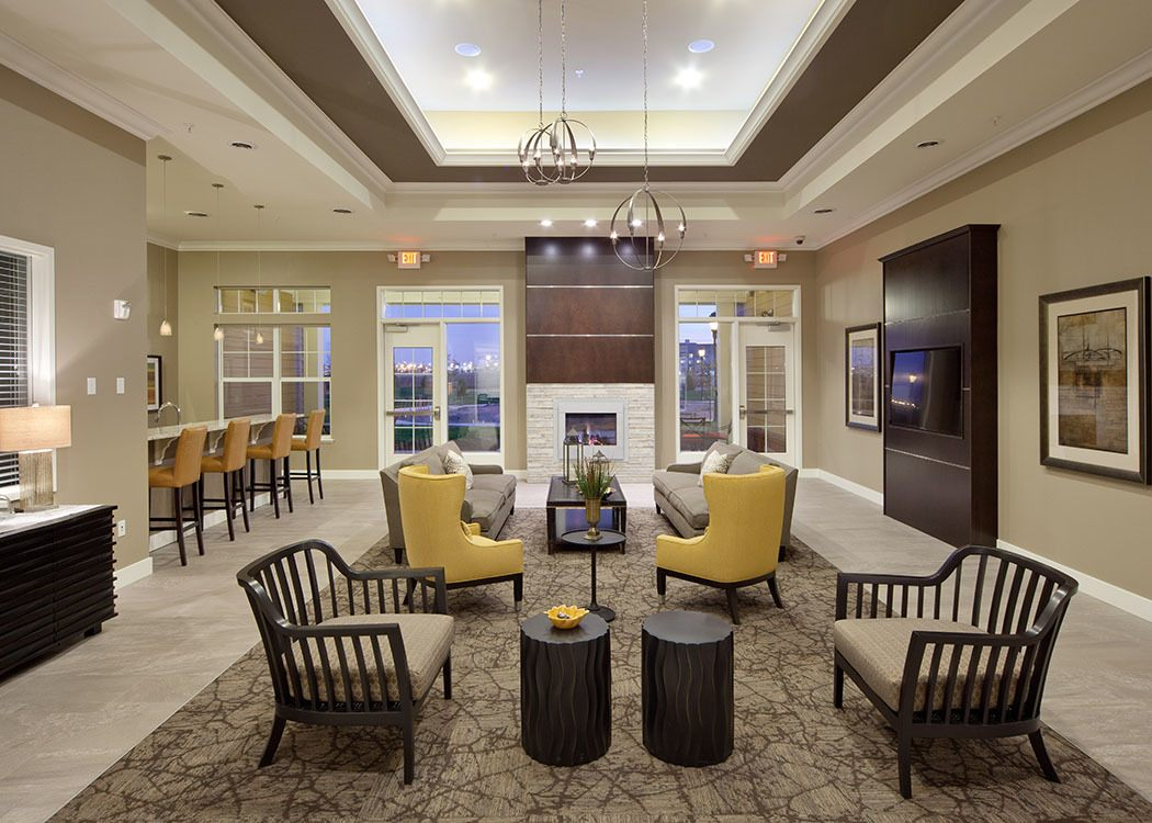 Relax and socialize in the common room at Skye at Arbor Lakes in Maple Grove, MN.