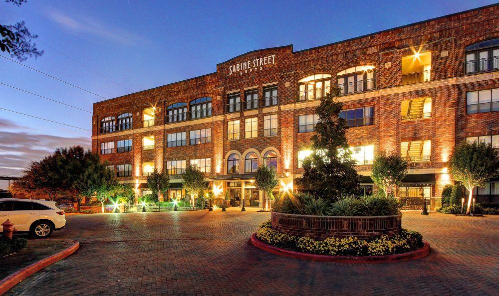 Illuminated building at apartments in Houston, TX