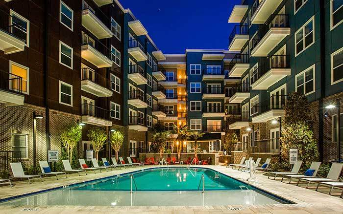 illuminated swimming pool at Marq Midtown 205 in Charlotte, NC