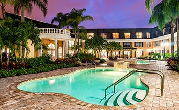 Our wonderful community here at Grand Villa of Delray West is stunning in the evening!