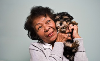 Another joyous Grand Villa of Pinellas Park resident enjoying a moment with her puppy