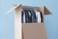 Hang clothes and draperies in wardrobe boxes