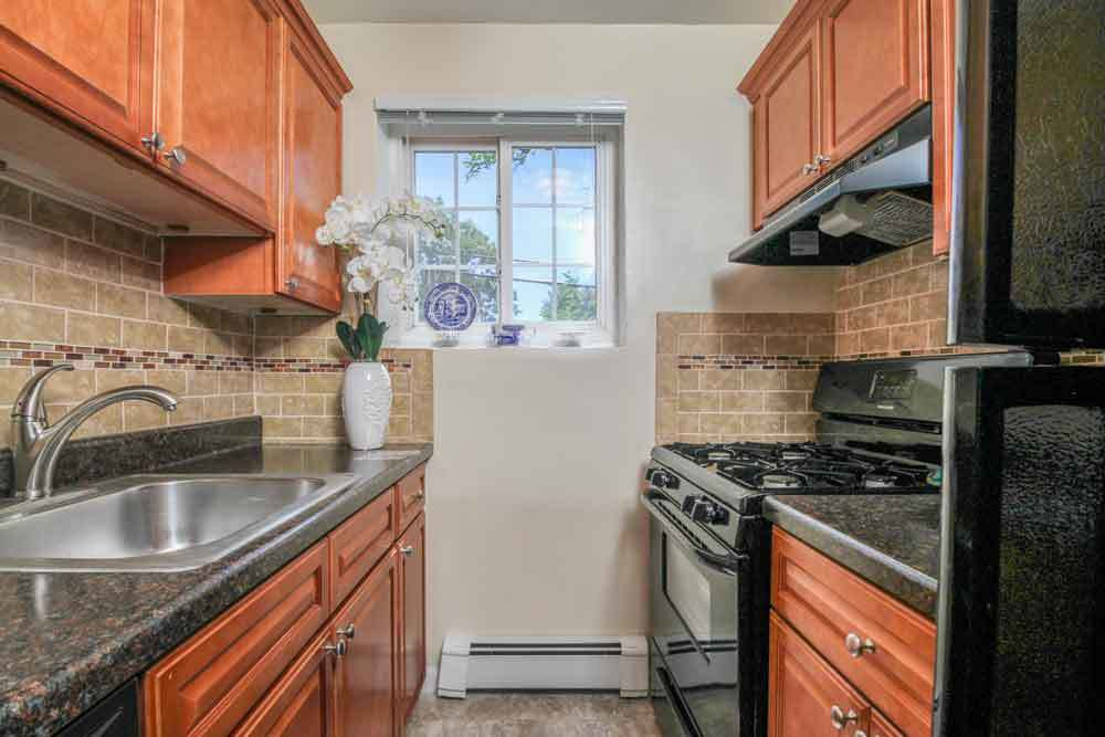 Kitchen at Eagle Rock Apartments of Carle Place.