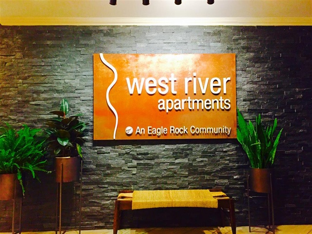 Entrance sign at West River Apartments.