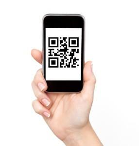 iPhone with QR code on screen.