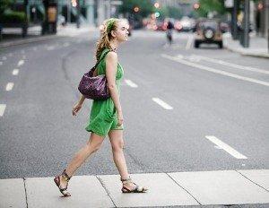 Woman crossing the street.