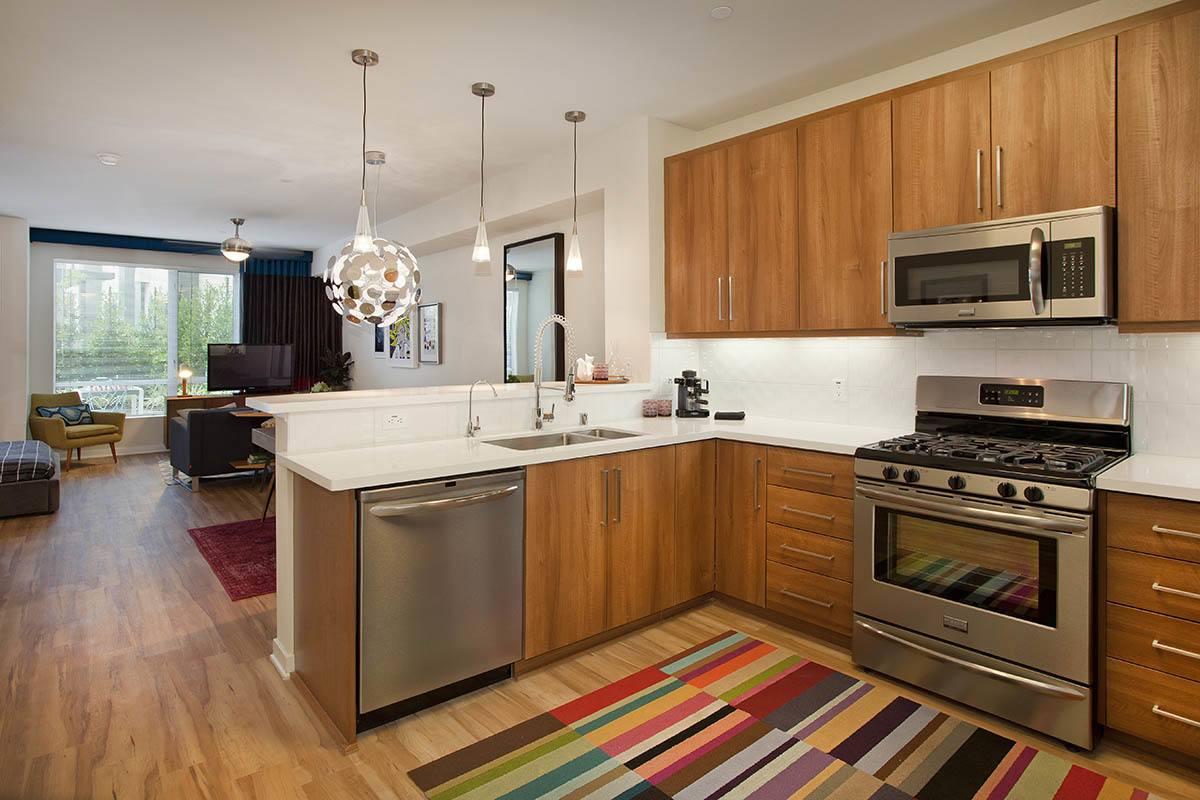 Kitchen complete with hardwood floors
