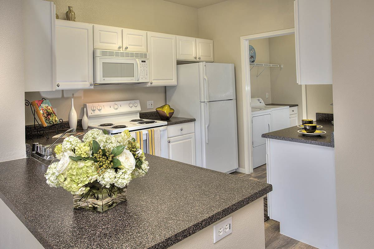 Kitchen With White Cabinets at Cross Pointe Apartment Homes in Antioch
