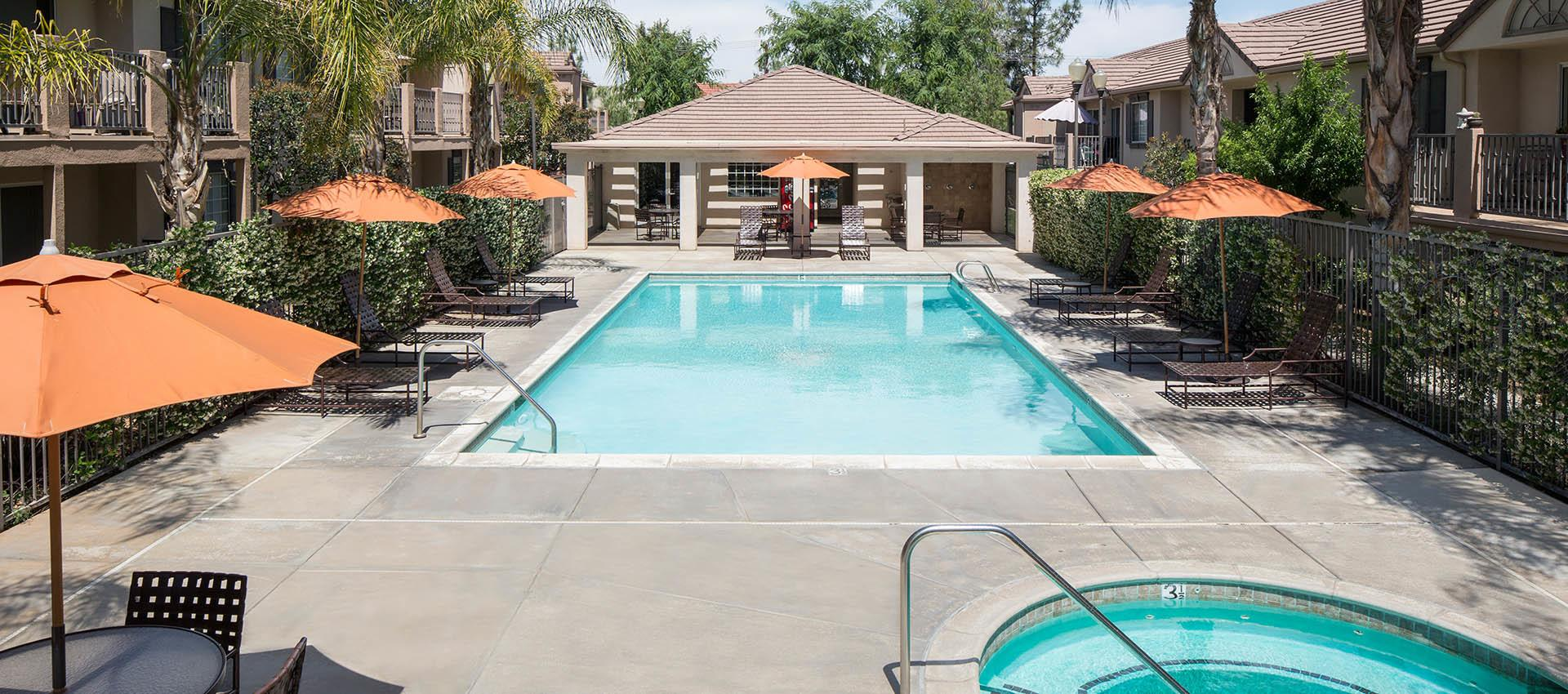 Expansive Pool Deck With Spa at Cypress Villas Apartment Homes in Redlands