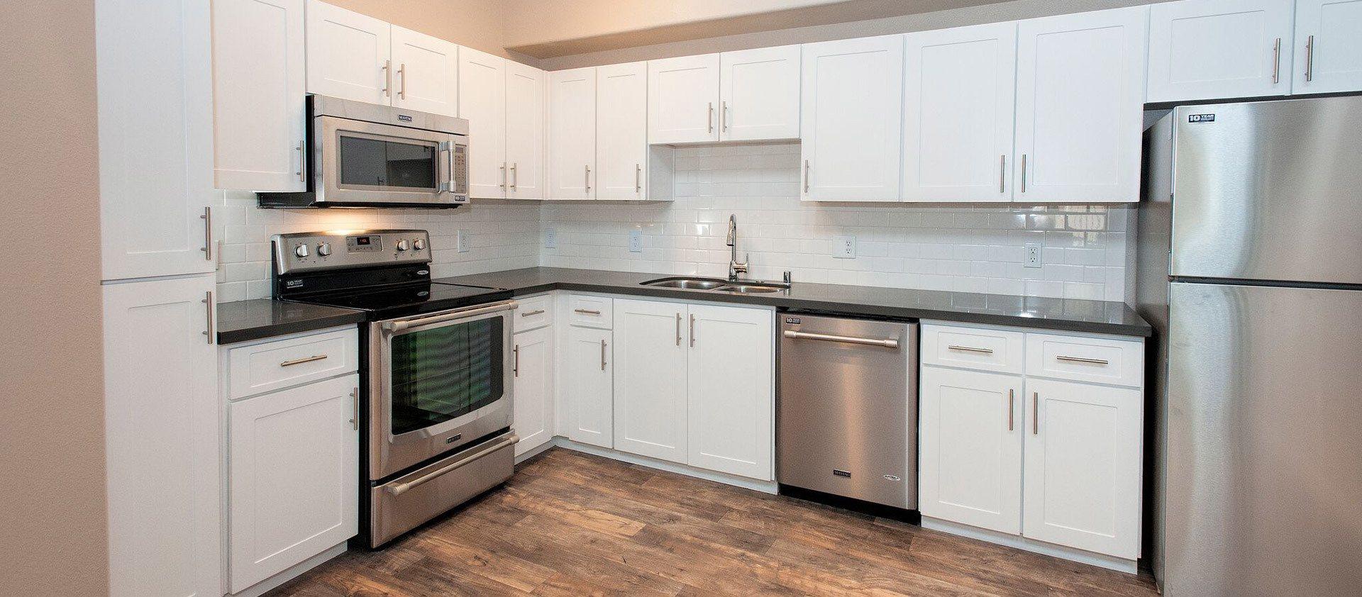 White shaker style cabinets at Venu at Galleria Condominium Rentals in Roseville, CA