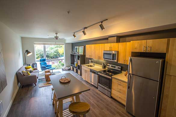Apartment features include hardwood-style flooring & stainless-steel appliances at Montessa in Portland, Oregon