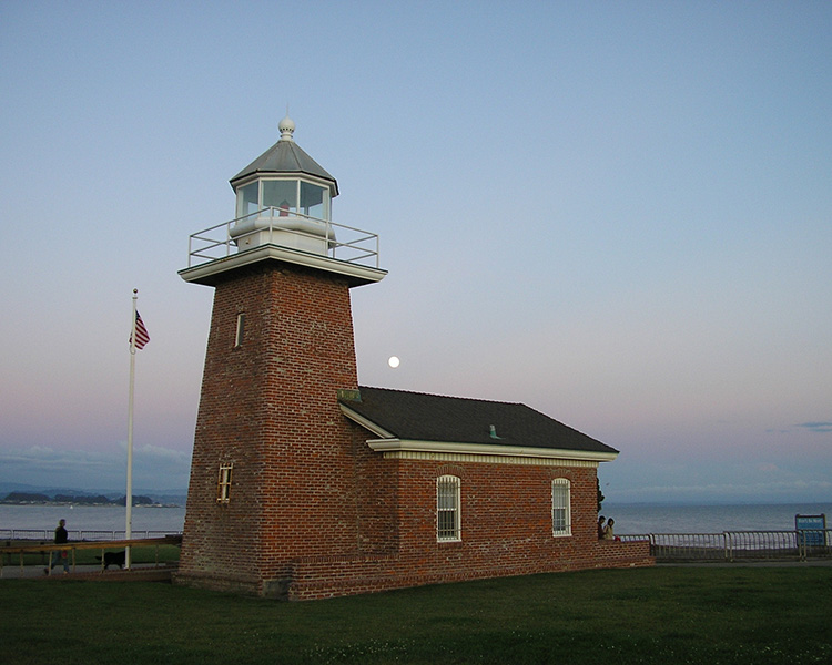 View of a local lighthouse at dusk near Pacific Shores apartments