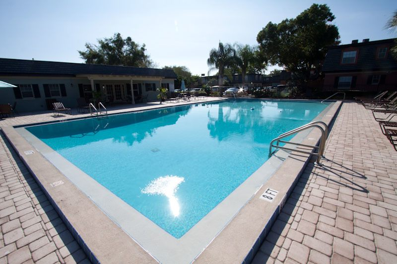Cool off in our beautiful swimming pool at Andover at Winter Park Apartments