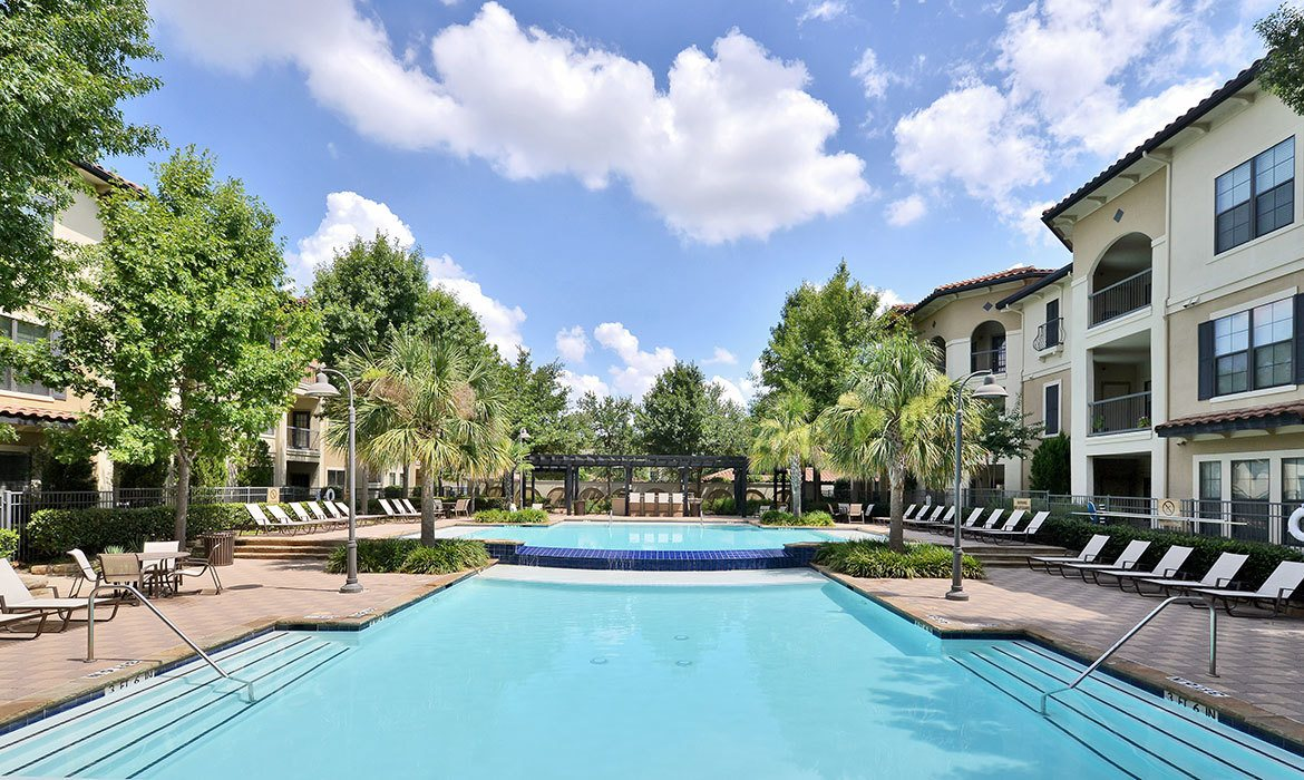 Our sparkling swimming pool area at Mission at La Villita beckons on warm days here in Irving, TX.