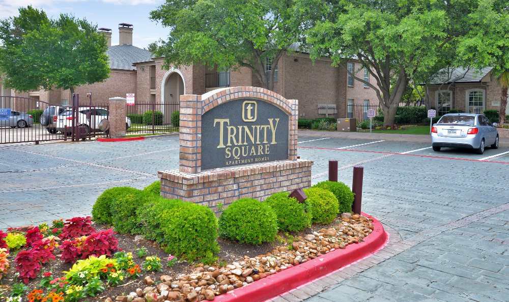 Our sparkling swimming pool area at Trinity Square Apartment Homes beckons on warm days here in Dallas, TX.