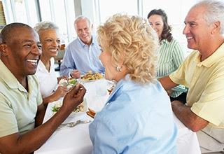 Friends enjoying food at the senior living in Salt Lake City