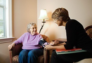 Doctor checking resident blood pressure at the senior living community in Feasterville Trevose