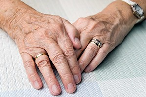 Saint George senior living shows a resident's hands